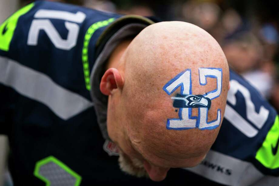 Former Mariners player Jay Buhner shows off his home team pride at the final Seahawks regular season game with a 12th Man rally Sunday, Dec. 29, 2013, at CenturyLink Field in Seattle. The Seahawks led the Rams 13-0 at the half. Photo: JORDAN STEAD, SEATTLEPI.COM / SEATTLEPI.COM