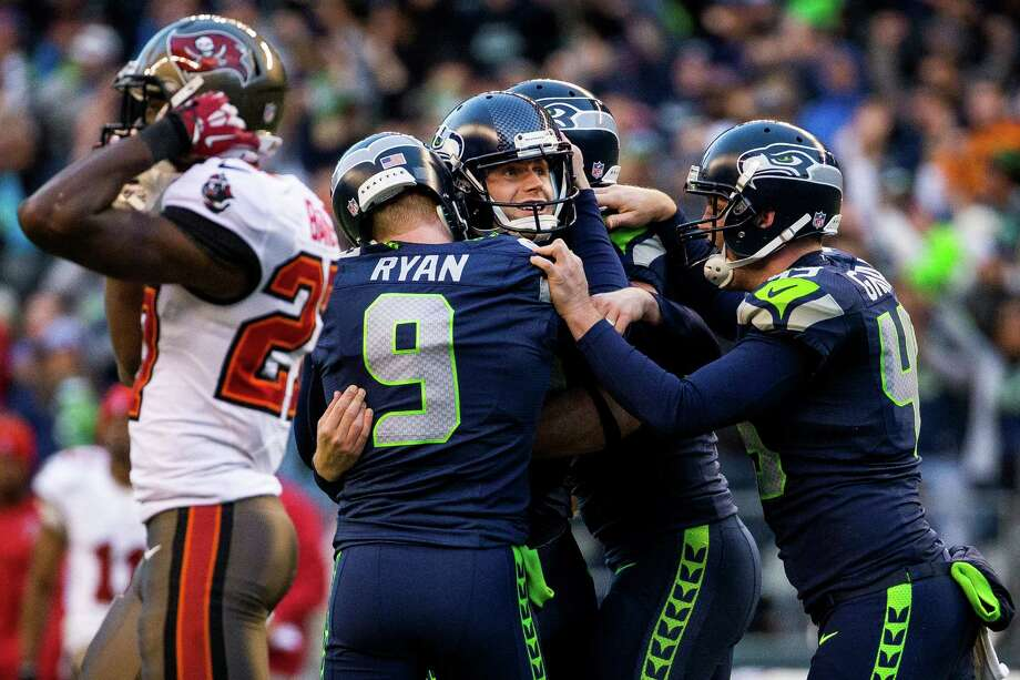 Seahawks kicker Steven Hauschka, center, is swarmed by teammates after kicking in the winning field goal against the Buccaneers in overtime Sunday, Nov. 3, 2013, at CenturyLink Field in Seattle. The Seahawks beat the Buccaneers 27-24 in the biggest comeback in franchise history. Photo: JORDAN STEAD, SEATTLEPI.COM / SEATTLEPI.COM