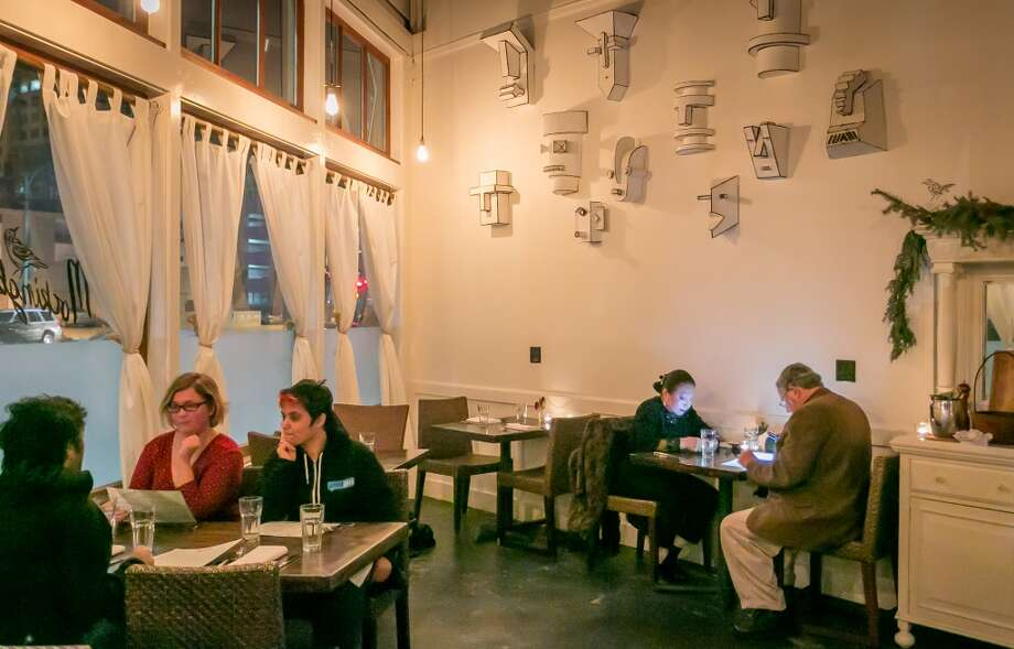 Diners enjoy dinner at Mockingbird in Oakland. Photo: John Storey, Special To The Chronicle