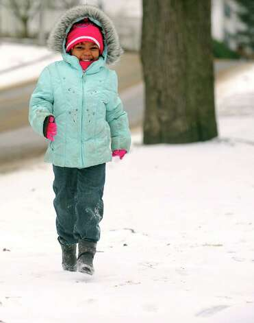 Four-year-old Nevaeh James, of Ansonia, walks down a snow covered street Thursday, Jan. 2, 2013 in Ansonia, Conn. Photo: Autumn Driscoll / Connecticut Post