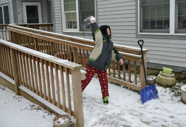 Robby Wood, 13, of New Milford, throws a snowball outside of his grandmother's home in Ridgefield, Conn. on Thursday, Jan. 2, 2014. Photo: Tyler Sizemore / The News-Times