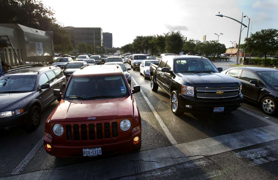 Traffic is seen on Westheimer and Post Oak, Friday, June 28, 2013, in Houston. Photo: Cody Duty, Houston Chronicle