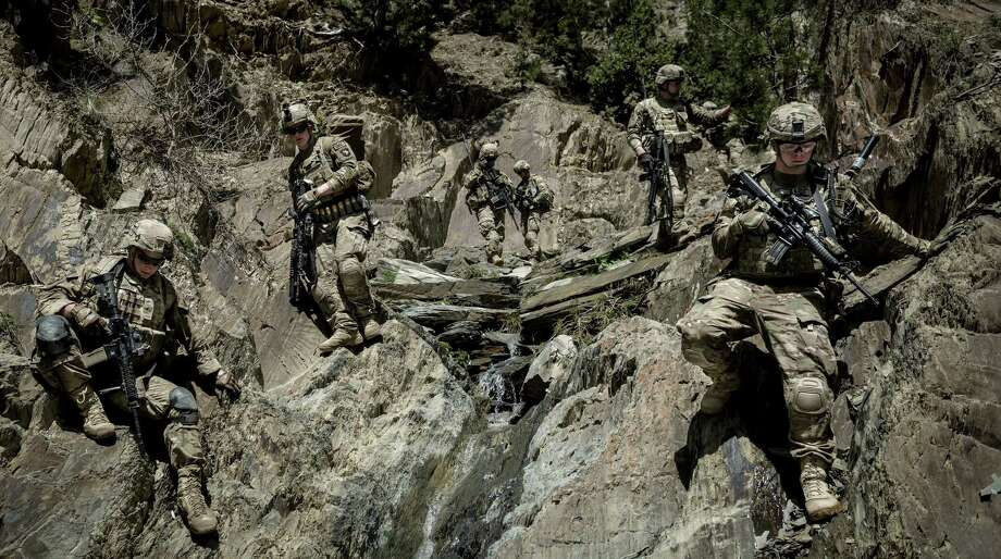 Soldiers with the 3rd Brigade Combat Team, 101st Airborne Division, climb down the mountains in Paktia Province, Afghanistan, on April 15. A plan to keep U.S. troops there through 2024 and beyond is meeting resistance. Photo: New York Times File Photo / NYTNS
