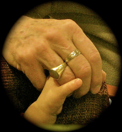The Circle of Life, one hand leading the other into a love shared by a grandparent and grandchild is