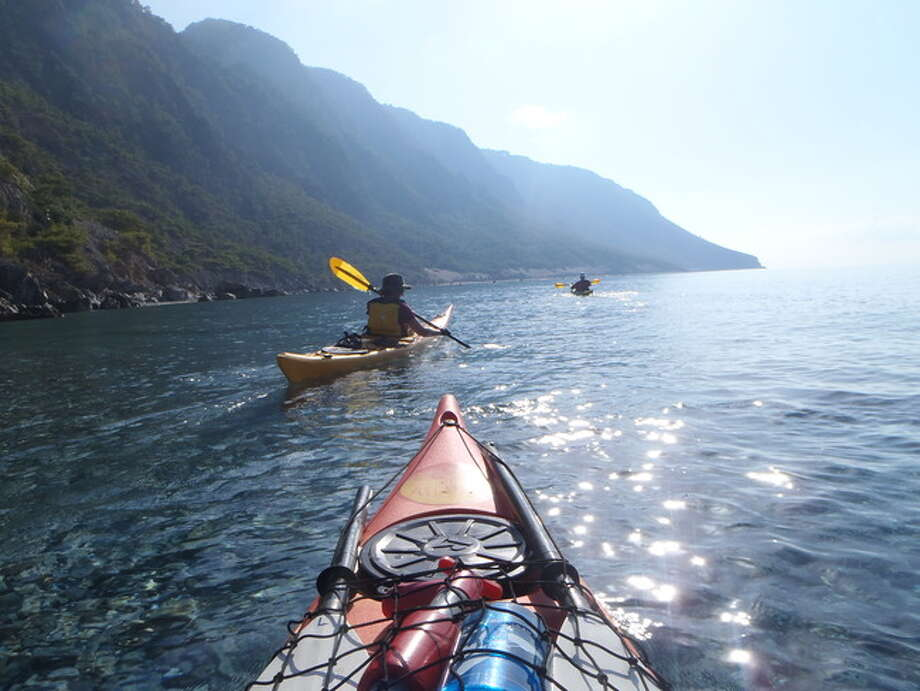 Kayaking to Loutro from Agia Roumeli Paddling from Agia Roumeli to Loutro, we keep our eyes open for sea turtles and kri-kri! The Northwest Passage kayaks to Loutro, a water-access only, traditional village on the south coast of Crete. Photo: Dana Paskiewicz, AFAR.com