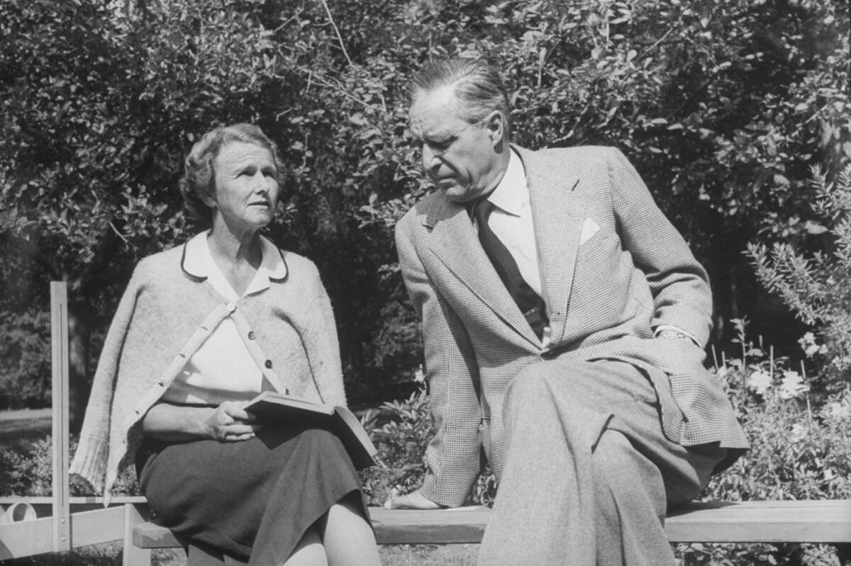 Conn. Senator Prescott S. Bush, is seen sitting in his garden while his wife Dorothy reading to him.