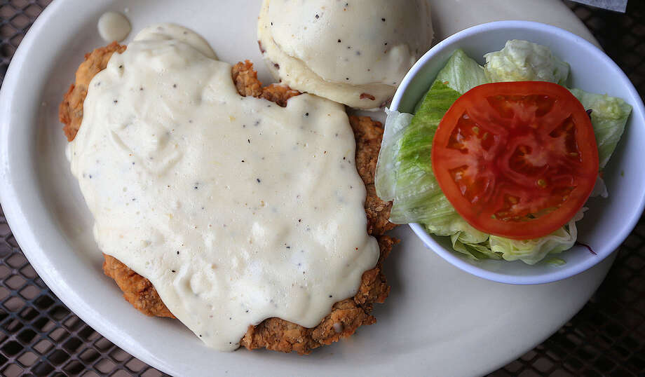 A chicken fried steak would make a good state appetizer because all that gravy aids in digestion. Texans eat big, so of course we'd want some help digesting our main meals with the best delivery system for gravy ever created. Photo: Photos By Jerry Lara / San Antonio Express-News / © 2013 San Antonio Express-News