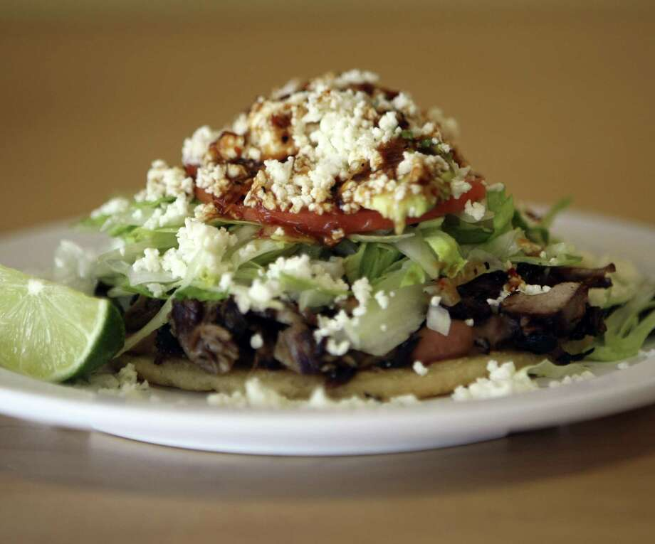Metro Basilica 2 serves a small menu of masa-based dishes from the interior of Mexico that burst with freshness and flavor. Above is a sope with carnitas. Photo: Express-News File Photos / SAN ANTONIO EXPRESS-NEWS