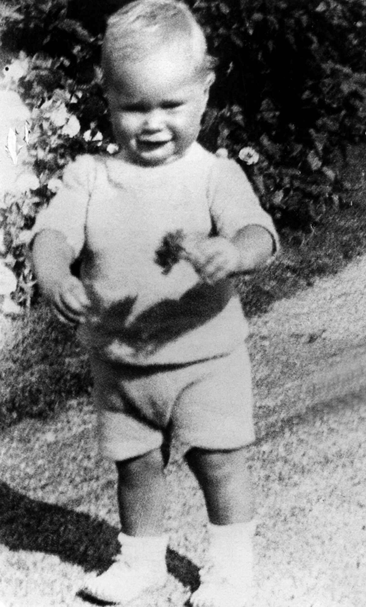 George H.W. Bush is pictured when he was one and a half year old. Born 12 June 1924 in Milton, Massachusetts, George Bush Yale graduated with a degree in Economics in 1948, made a fortune drilling oil before entering politics in 1964.