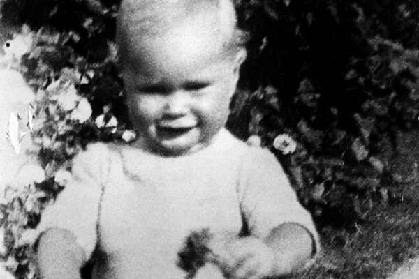George H.W. Bush is pictured when he was one and a half year old. Born 12 June 1924 in Milton, Massachussetts, George Bush yale graduated with a degree in Economics in 1948, made a fortune drilling oil before entering politics in 1964.              (FILM)          (Photo credit should read /AFP/Getty Images)