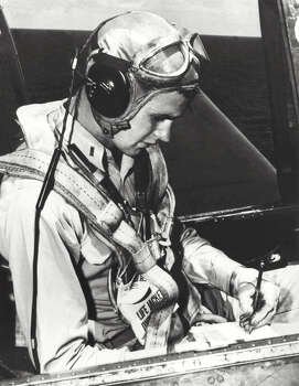 George H.W. Bush is pictured in the cockpit of his TBM Avenger during the World War II. Photo: AFP, AFP/Getty Images / 2012 AFP