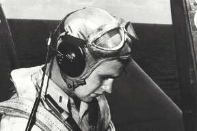George H.W. Bush is pictured in the cockpit of his TBM Avenger during the World War II.