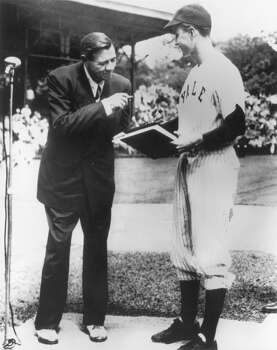 New York Yankees baseball legend Babe Ruth shakes hands with future U.S. president George H.W. Bush after signing an autograph for him, circa 1946. Bush wears his uniform for the Yale University baseball team. Photo: Consolidated News Pictures, Getty Images / Archive Photos
