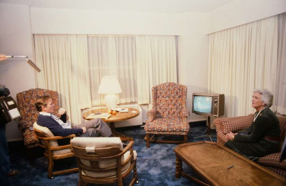 During his campaign for the Republican presidential nomination, American politician  George H.W. Bush (left) sits with his wife, future First Lady Barbara Bush, and watch television in Iowa, January 1980. Photo: Robert R. McElroy, Getty Images