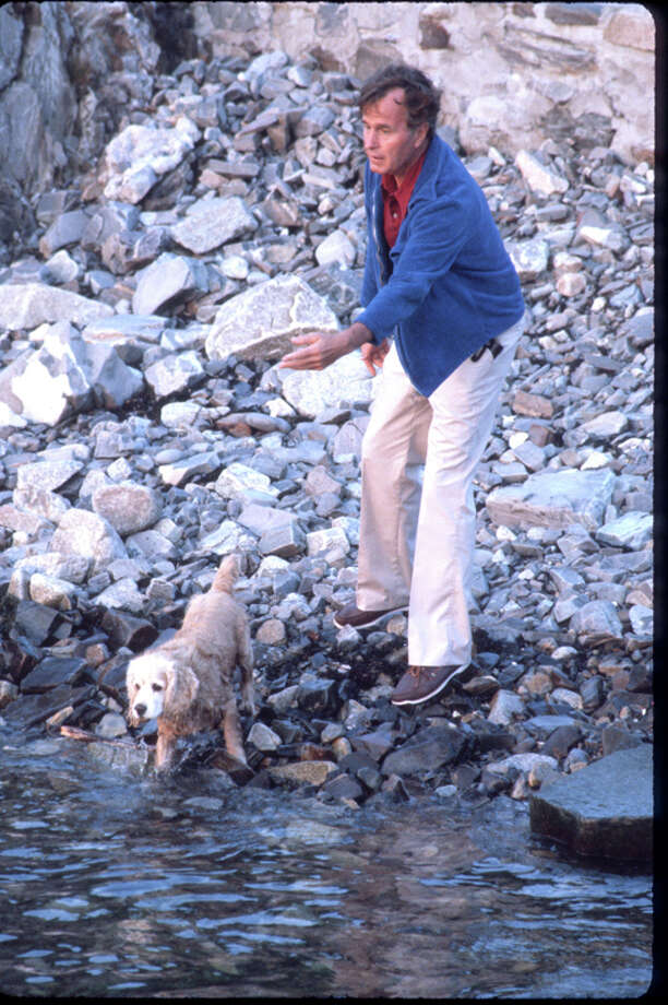 George H.W. Bush plays with his dog Fred July 1980. Photo: Dirck Halstead, Getty Images / Hulton Archive