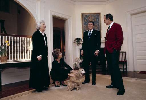 (L-R) Barbara Bush, First Lady Nancy Reagan, President Ronald Reagan, Vice President George H.W. Bush stand around the Bush's Golden Cocker Spaniel at the Vice Presidential residence in 1981 in Washington, DC. This was the first Reagan visit to the vice president's residence. Photo: David Hume Kennerly, Getty Images