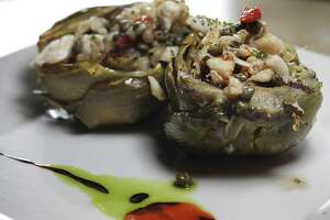 Grilled artichoke with crab vinaigrette by chef Damien Watel at Chez Vatel & Bistro on Friday, Dec. 20, 2013.