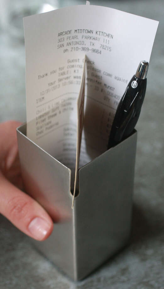 Check it out: Arcade Midtown Kitchen presents the bill in a stylish stainless-steel box. Photo: JOHN DAVENPORT, SAN ANTONIO EXPRESS-NEWS / ©San Antonio Express-News/Photo may be sold to the public