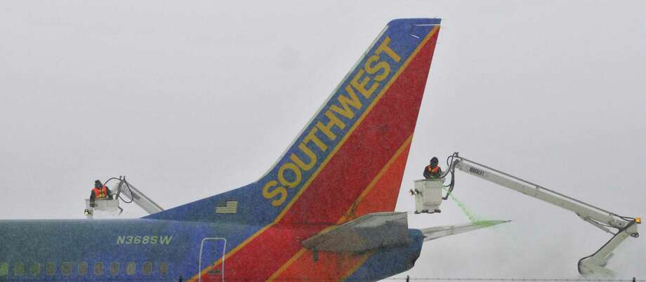 Crews work on de-icing a SouthWest jet at  Albany International Airport on Thursday, Jan. 2, 2014 in Colonie, NY.     (Paul Buckowski / Times Union) Photo: PAUL BUCKOWSKI / 00025207A