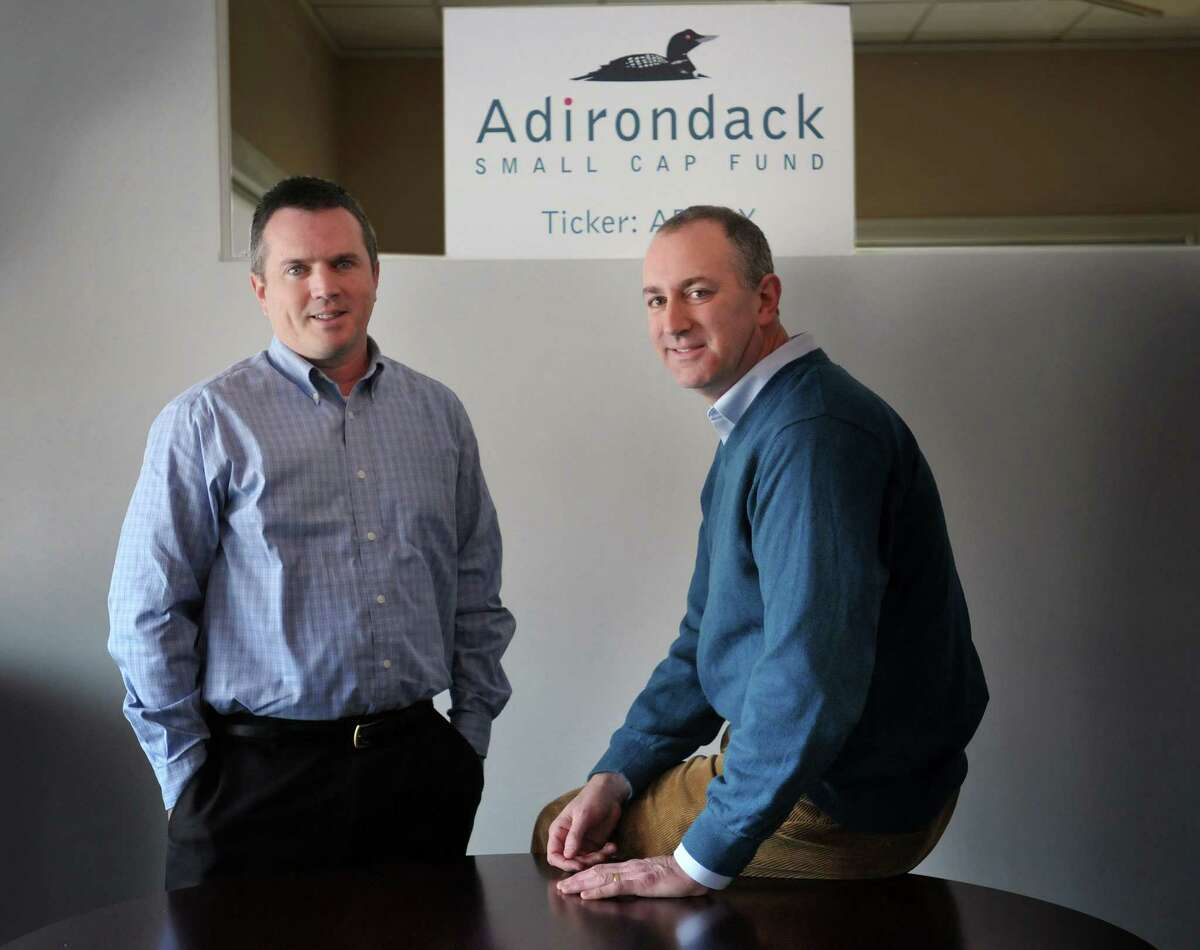 Matt Reiner, left, a portfolio manager at Adirondack Funds and Steve Gonick, a principal at Adirondack Funds, seen here at their office on Tuesday, Dec. 31, 2013 in Guilderland, NY. (Paul Buckowski / Times Union)