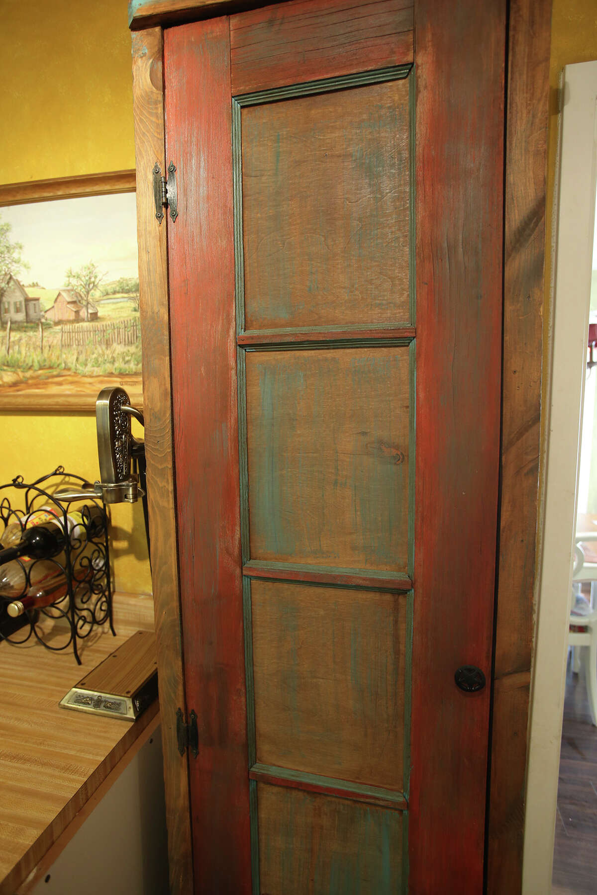 Melissa Hix's father made a pantry using an old door.