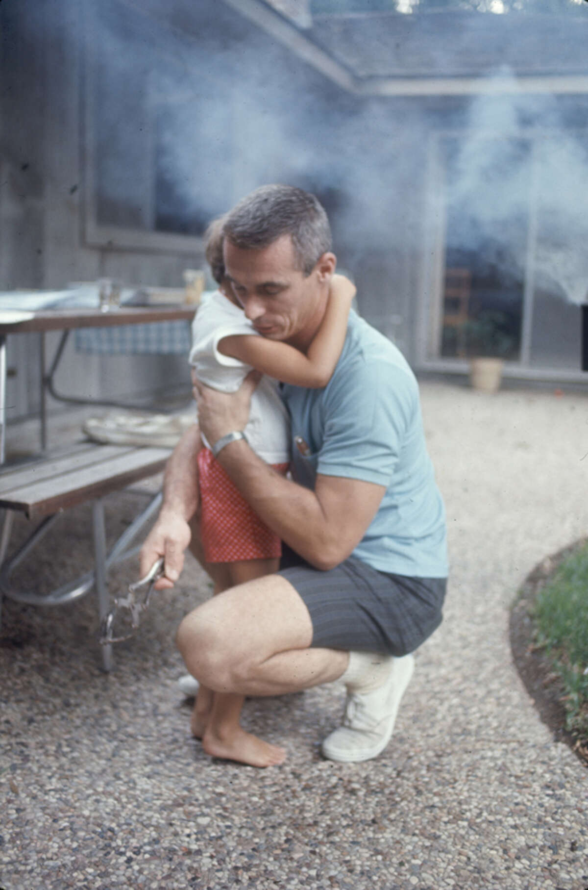 PHOTOS: Early astronauts at home with wither families in Houston American NASA astronaut Eugene Cernan crouches down to hug his daughter, Tracy. The pair were at a March 1969 barbecue at the Houston home of fellow astronaut Jim Young.