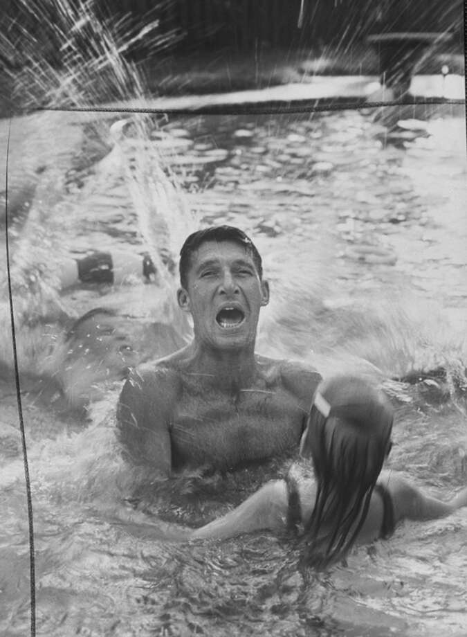 Astronaut, Walter M. Schirra swims at home with his children. Photo: Leonard McCombe, Time & Life Pictures/Getty Image / Time Life Pictures