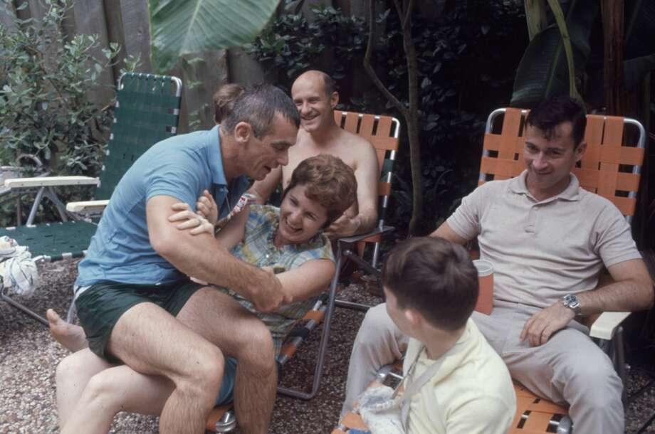 American astronaut Eugene Cernan (in blue), Thomas Stafford (center, shirtless), and John Young (right) clown about with their families during a barbecue outside Young's home in Houston in 1969. The three men were the back-up crew for the Apollo 7 mission. Photo: Ralph Morse, Time & Life Pictures/Getty Image