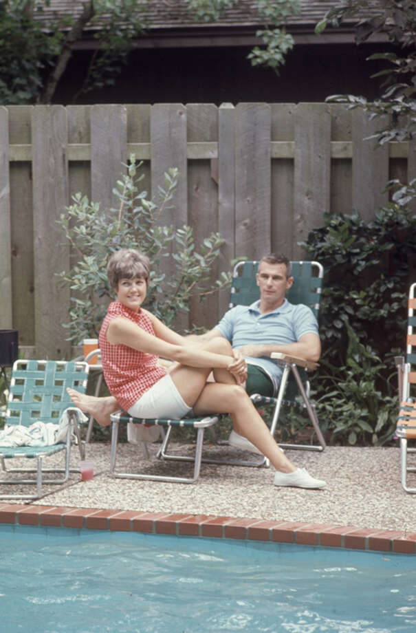 American astronaut Eugene Cernan and his wife, Barbara, relax beside a swimming pool during a barbecue at fellow astronaut John Young's home in Houston in 1968. Photo: Ralph Morse, Time & Life Pictures/Getty Image / Time & Life Pictures