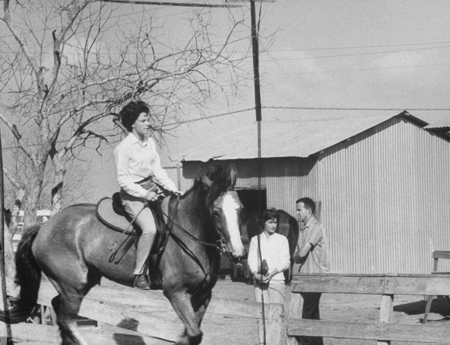 Astronaut Gordon Cooper and wife Trudy watch their daughter Jan ride at stable. Photo: Ralph Morse, Time & Life Pictures/Getty Image