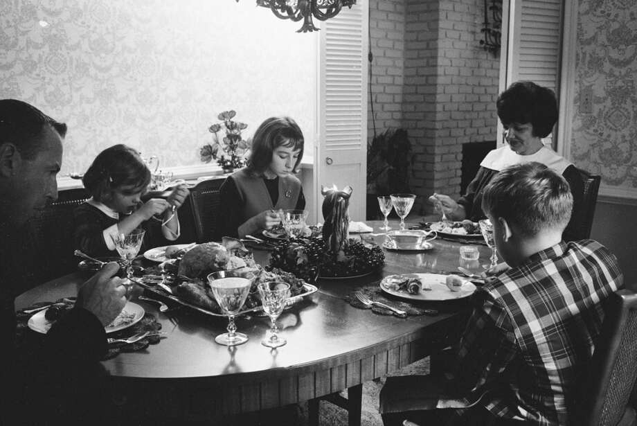 American astronaut Jim Lovell eats a turkey dinner with his family in Houston,  November 1965. Clockwise from left, Lovell, daughters Susan and Barbara, wife Marilyn, and son James (Jay). Photo: Ralph Morse, Time & Life Pictures/Getty Image
