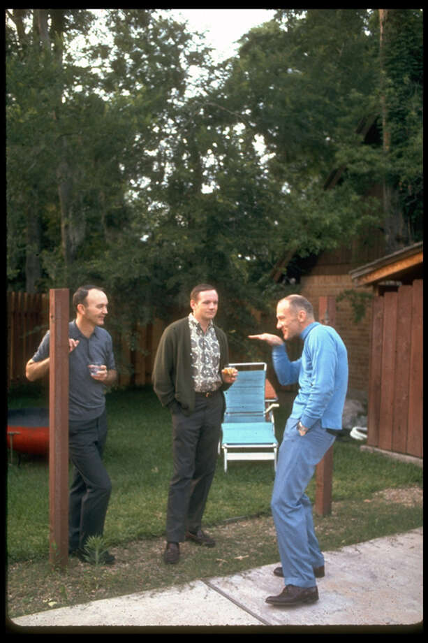 Astronauts Michael Collins, Neil Armstrong and Buzz Aldrin relax in a backyard. Photo: Ralph Morse., Time & Life Pictures/Getty Image / Time & Life Pictures
