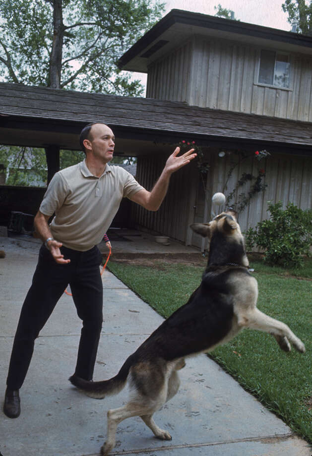 American astronaut Michael Collins plays catch with his dog in the driveway of his Houston home in 1969. Photo: Ralph Morse, Time & Life Pictures / Time & Life Pictures