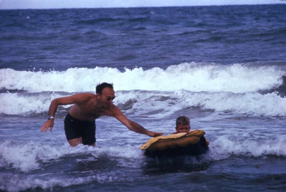 American astronaut Michael Collins plays in the surf with his son Michael Jr. at a beach near Houston, March 1969. Photo: Ralph Morse, Time & Life Pictures/Getty Image