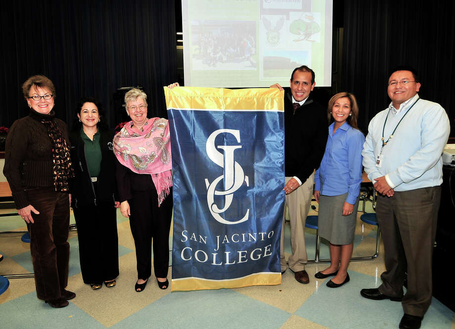 From left, Kaye Moon Winters, Claudia Harmon, Jaynie Mitchell, Edgar Lopez, Tania Ramirez and Joe Saavedra show a flag given to Jackson Intermediate School. Photo: Provided By Jackson Intermediate School