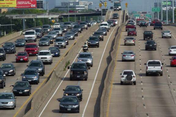 Drivers head northwestward in the HOV lane on U.S. 290. Starting Monday, solo drivers in local toll lanes will pay higher fees and have less access.