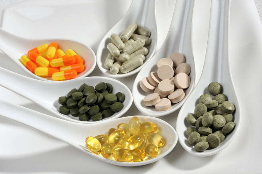 The FDA bans the sale of diet drugs and supplements containing ephedra after it's linked to heart attacks.