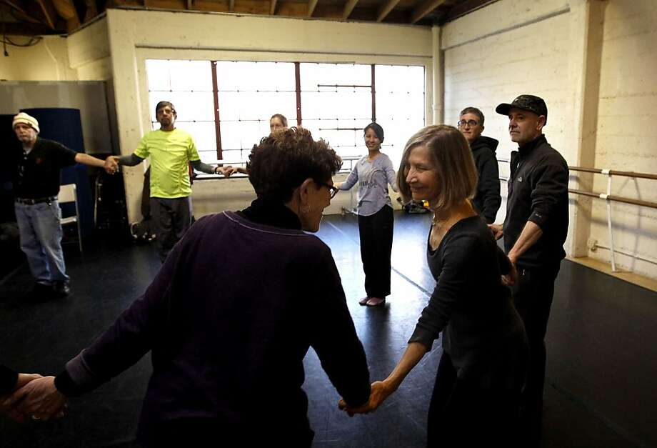 Susan Weber (right), who leads the dance class, chats with Judy Leash, who supports people with movement disorders. Photo: Michael Macor, The Chronicle