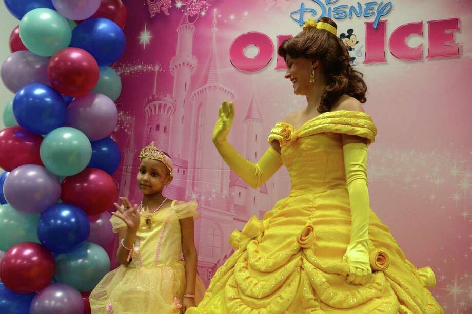 Children from the Connecticut chapter of Sunshine Kids, a non-profit organization dedicated to children with cancer, spend time being made-over into their favorite Disney Princesses Thursday, Jan. 2, 2014.  The event celebrates the arrival of Disney On Ice presents Princesses and Heroes which will be at the Webster Bank Arena in Bridgeport, Conn. from January 2nd through the 5th. Photo: Autumn Driscoll / Connecticut Post