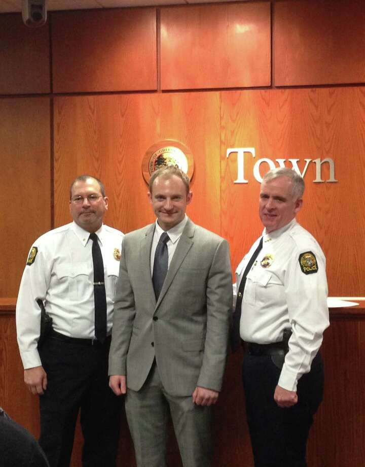 New Greenwich Police recruit Kyle Rillet, center, poses with Deputy Chief Mark Marino, left, and Police Chief James Heavey at Town Hall Thursday. Photo: Contributed Photo / Greenwich Time contributed