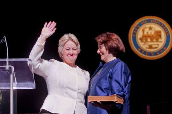 Mayor Annise Parker takes the oath of office for a third and final term Thursday with her partner, Kathy Hubbard, at her side.