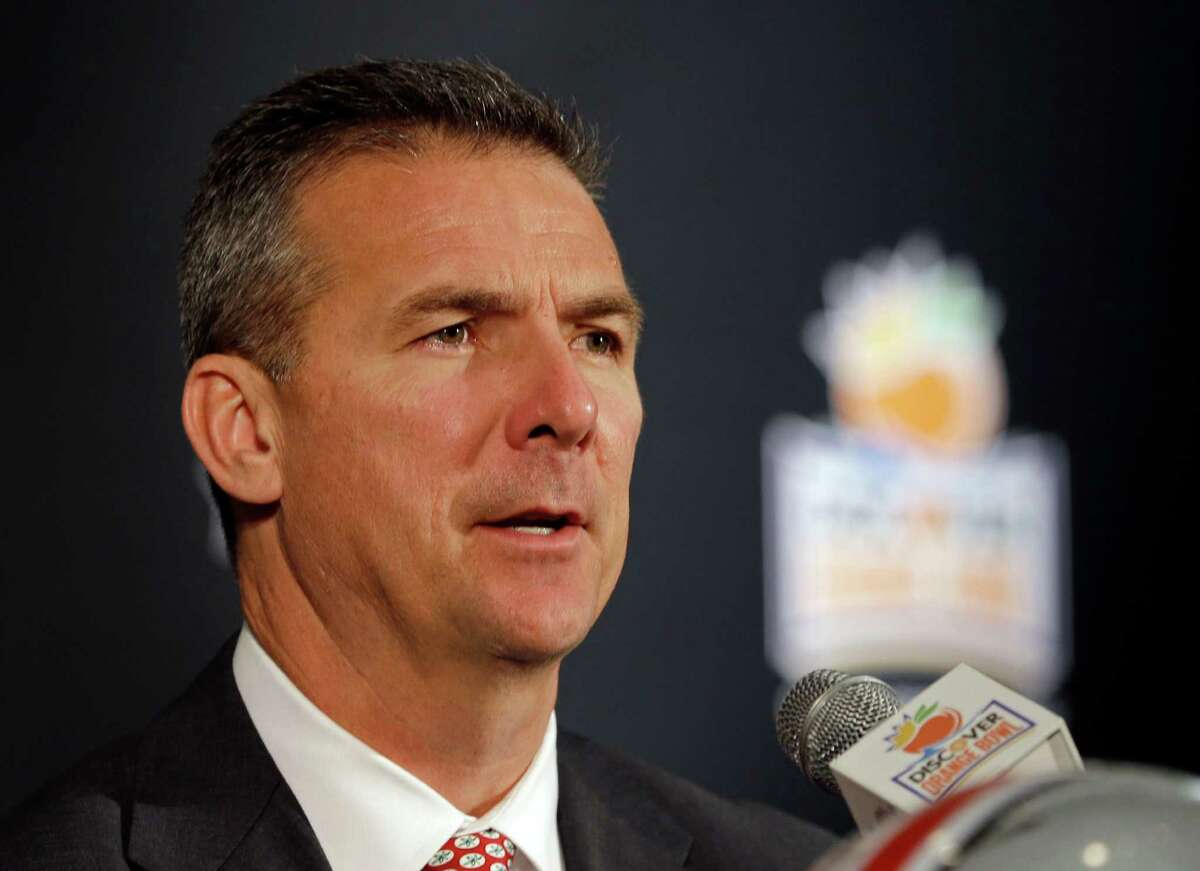 Ohio State head coach Urban Meyer answers a question during a news conference in Fort Lauderdale, Fla., Thursday, Jan. 2, 2014. Ohio State will face Clemson in the NCAA college football Orange Bowl classic, Friday, Jan. 3, in Miami Gardens, Fla. (AP Photo/Alan Diaz)