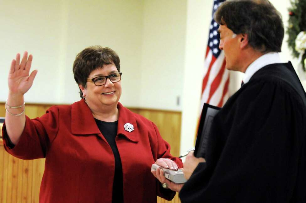 Town Clerk Elizabeth DelTorto, left, takes the oath of office from Judge Peter Crummey on Thursday, Jan. 2, 2014, at Colonie Town Hall in Colonie, N.Y. (Cindy Schultz / Times Union)