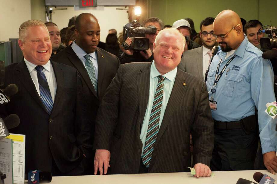 Toronto Mayor Rob Ford registers as a candidate Thursday, Jan. 2, 2014, for the city's 2014 municipal election in October. Councillor Doug Ford is at left. (AP Photo/The Canadian Press, Victor Biro) ORG XMIT: CPT102 Photo: Victor Biro / The Canadian Press