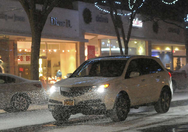 A vehicle navigates the the hazardous weather conditions during the snow storm that hit Greenwich, Conn., Thursday night, Jan. 2, 2014. Photo: Bob Luckey / Greenwich Time