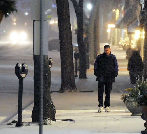 A man walks south on Greenwich Avenue during the snow storm that hit Greenwich, Conn., Thursday night, Jan. 2, 2014. Photo: Bob Luckey / Greenwich Time