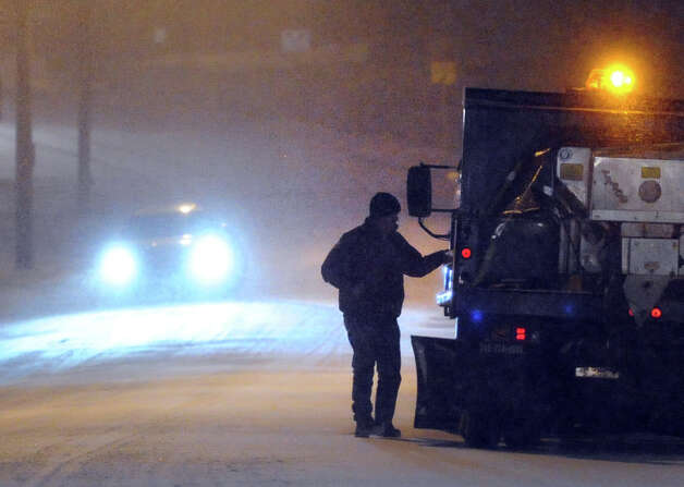 A plowman gets into his truck on West Elm Street during the snow storm that hit Greenwich, Conn., Thursday night, Jan. 2, 2014. Photo: Bob Luckey / Greenwich Time