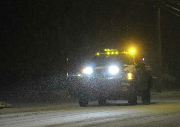 A plow truck on West Putnam Avenue during the snow storm that hit Greenwich, Conn., Thursday night, Jan. 2, 2014. Photo: Bob Luckey / Greenwich Time