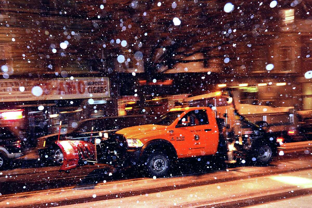A plow truck on Railroad Avenue during the snow storm that hit Greenwich, Conn., Thursday night, Jan. 2, 2014.