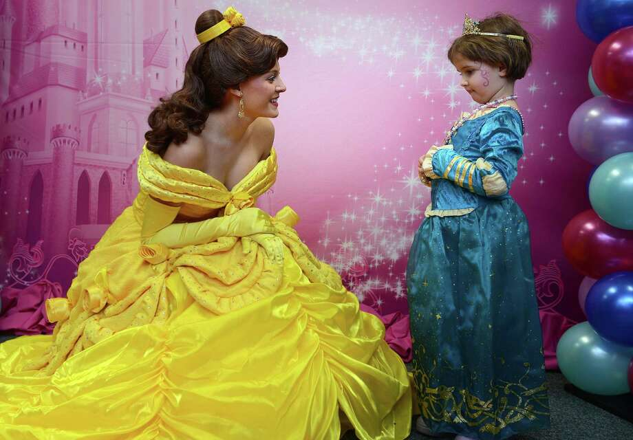 Five-year-old Meredith Ross, of Vernon, meets Belle, from Disney On Ice presents Princesses and Heroes, Thursday, Jan. 2, 2014 during a special day of princess training at Sports Center of Connecticut in Shelton, Conn.  The event was put on by Sunshine Kids, a non-profit organization dedicated to children with cancer, and Disney On Ice presents Princesses and Heroes which will be at the Webster Bank Arena in Bridgeport, Conn. from January 2nd through the 5th. Photo: Autumn Driscoll / Connecticut Post
